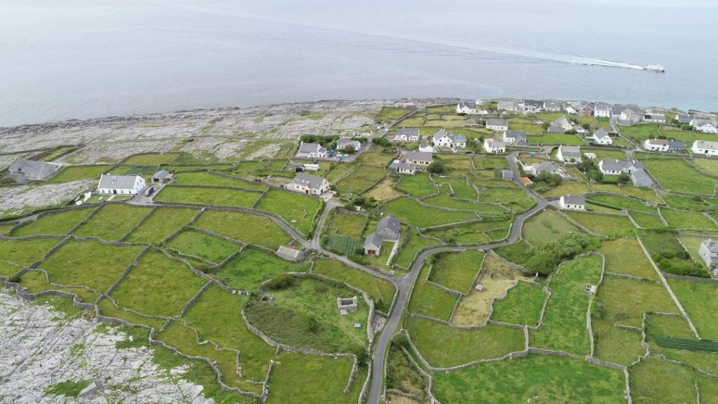 An aerial view of west village iInin Oírr with teampall (Cill) Ghobnait in the foreground
